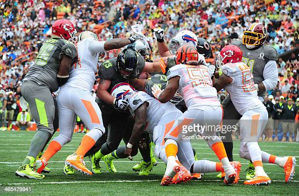 Cam Newton of the Carolina Panthers and Team Sanders attempts a quarterback sneak during the 2014 Pro Bowl against Team Rice at Aloha Stadium on...