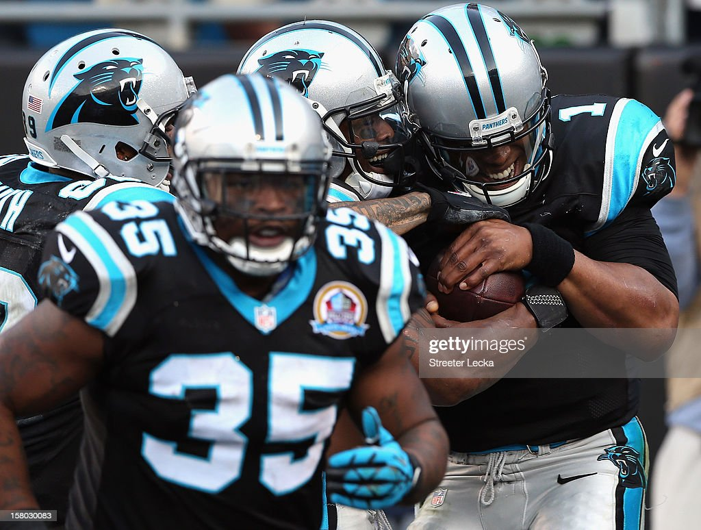 Cam Newton #1 of the Carolina Panthers and teammate DeAngelo Williams #34 celebrate after Williams run for a touchdown late in the game against the Atlanta Falcons at Bank of America Stadium on December 9, 2012 in Charlotte, North Carolina.