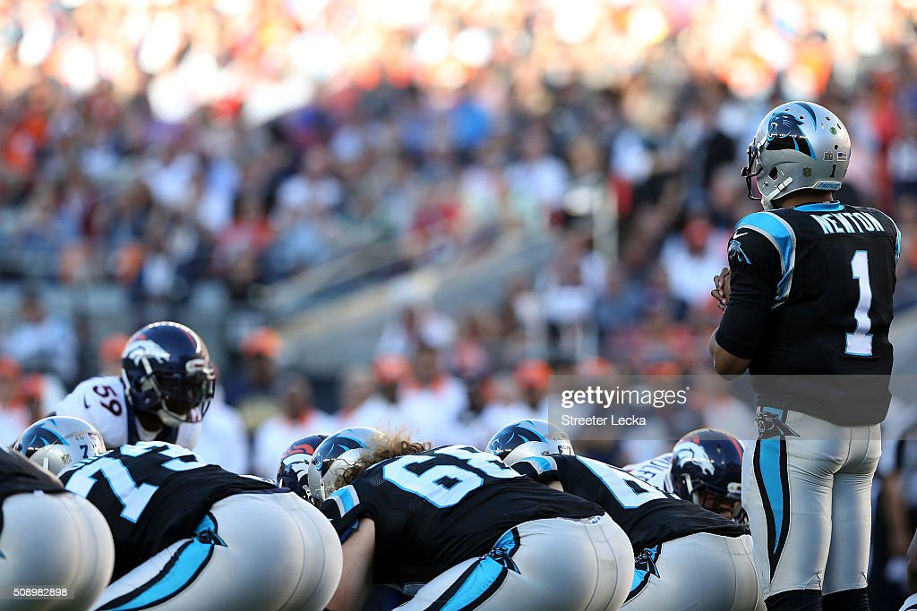 <a gi-track='captionPersonalityLinkClicked' href=/galleries/search?phrase=Cam+Newton+-+American+Football+Quarterback&family=editorial&specificpeople=4516761 ng-click='$event.stopPropagation()'>Cam Newton</a> #1 of the Carolina Panthers awaits the snap in the first quarter of Super Bowl 50 against the Denver Broncos at Levi's Stadium on February 7, 2016 in Santa Clara, California.