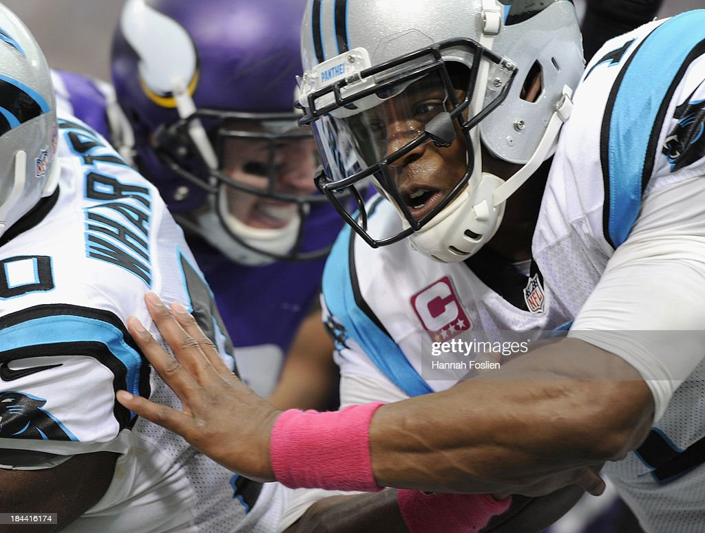 <a gi-track='captionPersonalityLinkClicked' href=/galleries/search?phrase=Cam+Newton+-+American+Football+Quarterback&family=editorial&specificpeople=4516761 ng-click='$event.stopPropagation()'>Cam Newton</a> #1 of the Carolina Panthers carries the ball during the second quarter of the game against the Minnesota Vikings on October 13, 2013 at Mall of America Field at the Hubert H. Humphrey Metrodome in Minneapolis, Minnesota. The Panthers defeated the Vikings 35-10.