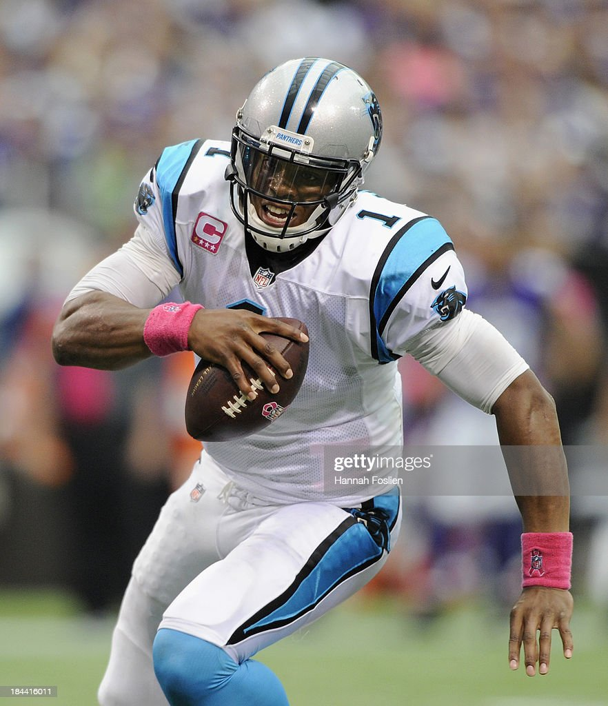 <a gi-track='captionPersonalityLinkClicked' href=/galleries/search?phrase=Cam+Newton+-+American+Football+Quarterback&family=editorial&specificpeople=4516761 ng-click='$event.stopPropagation()'>Cam Newton</a> #1 of the Carolina Panthers carries the ball during the third quarter of the game against the Minnesota Vikings on October 13, 2013 at Mall of America Field at the Hubert H. Humphrey Metrodome in Minneapolis, Minnesota. Newton scored a touchdown on the play and the Panthers defeated the Vikings 35-10.