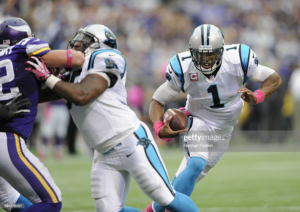 <a gi-track='captionPersonalityLinkClicked' href=/galleries/search?phrase=Cam+Newton+-+American+Football+Quarterback&family=editorial&specificpeople=4516761 ng-click='$event.stopPropagation()'>Cam Newton</a> #1 of the Carolina Panthers carries the ball during the third quarter of the game against the Minnesota Vikings on October 13, 2013 at Mall of America Field at the Hubert H. Humphrey Metrodome in Minneapolis, Minnesota. The Panthers defeated the Vikings 35-10.