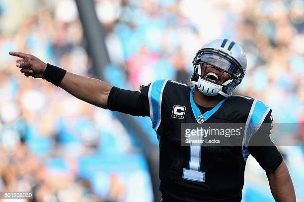 Cam Newton of the Carolina Panthers celebrates a 3rd quarter touchdown against the Atlanta Falcons during their game at Bank of America Stadium on...