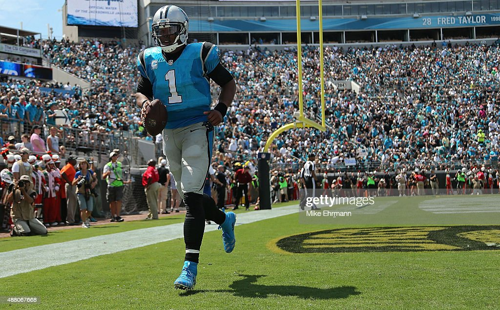 Cam Newton of the Carolina Panthers celebrates a touchdown during a game against the Jacksonville Jaguars at EverBank Field on September 13 2015 in...