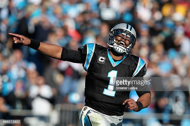 Cam Newton of the Carolina Panthers celebrates a touchdown pass against the Washington Redskins in the 2nd quarter during their game at Bank of...