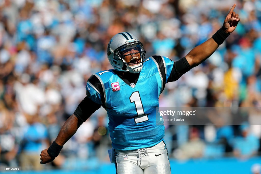<a gi-track='captionPersonalityLinkClicked' href=/galleries/search?phrase=Cam+Newton+-+American+Football+Quarterback&family=editorial&specificpeople=4516761 ng-click='$event.stopPropagation()'>Cam Newton</a> #1 of the Carolina Panthers celebrates after a touchdown by teammate Mike Tolbert #35 during their game against the St. Louis Rams at Bank of America Stadium on October 20, 2013 in Charlotte, North Carolina.