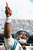 Cam Newton of the Carolina Panthers celebrates after a touchdown during the second quarter of the NFC Divisional Playoff Game against the Seattle...