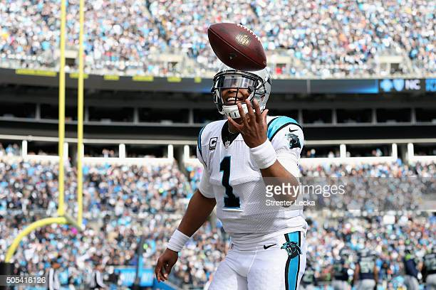 Cam Newton of the Carolina Panthers celebrates after a touchdown against the Seattle Seahawks in the 2nd quarter during the NFC Divisional Playoff...