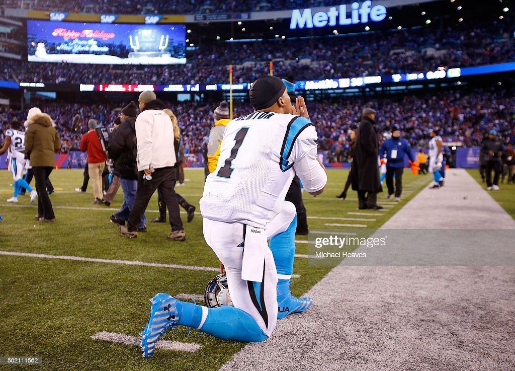 Cam Newton #1 of the Carolina Panthers celebrates after defeating the New York Giants in their game at MetLife Stadium on December 20, 2015 in East Rutherford, New Jersey. The Carolina Panthers defeated the New York Giants with a score of 38 to 35.