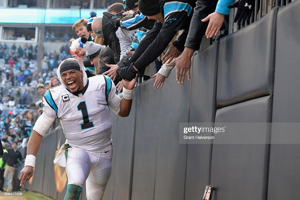 Cam Newton #1 of the Carolina Panthers celebrates after defeating the Seattle Seahawks 31-24 in the NFC Divisional Playoff Game at Bank of America Stadium on January 17, 2016 in Charlotte, North Carolina.