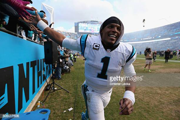 Cam Newton of the Carolina Panthers celebrates after defeating the Seattle Seahawks 3124 in the NFC Divisional Playoff Game at Bank of America...