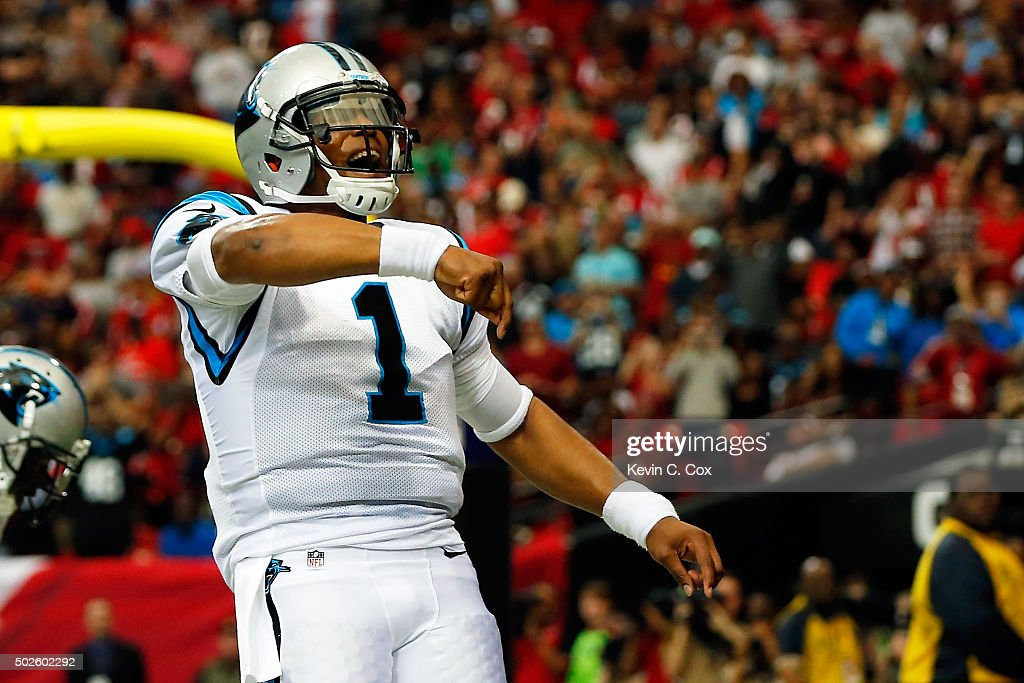 Cam Newton #1 of the Carolina Panthers celebrates after scoring a touchdown during the first half against the Atlanta Falcons at the Georgia Dome on December 27, 2015 in Atlanta, Georgia.