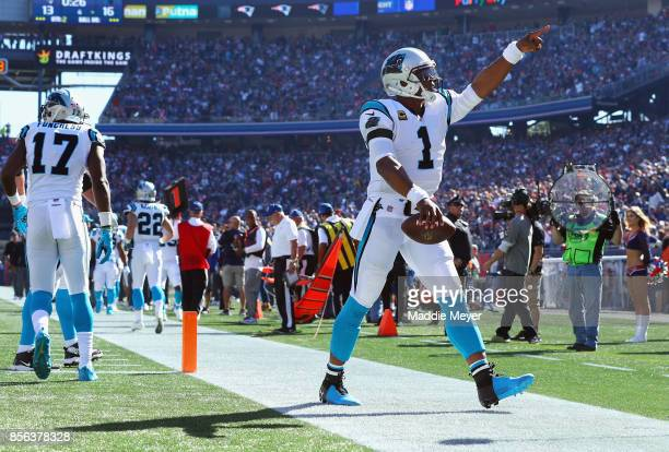 Cam Newton of the Carolina Panthers celebrates after throwing a touchdown pass to Devin Funchess during the second quarter against the New England...