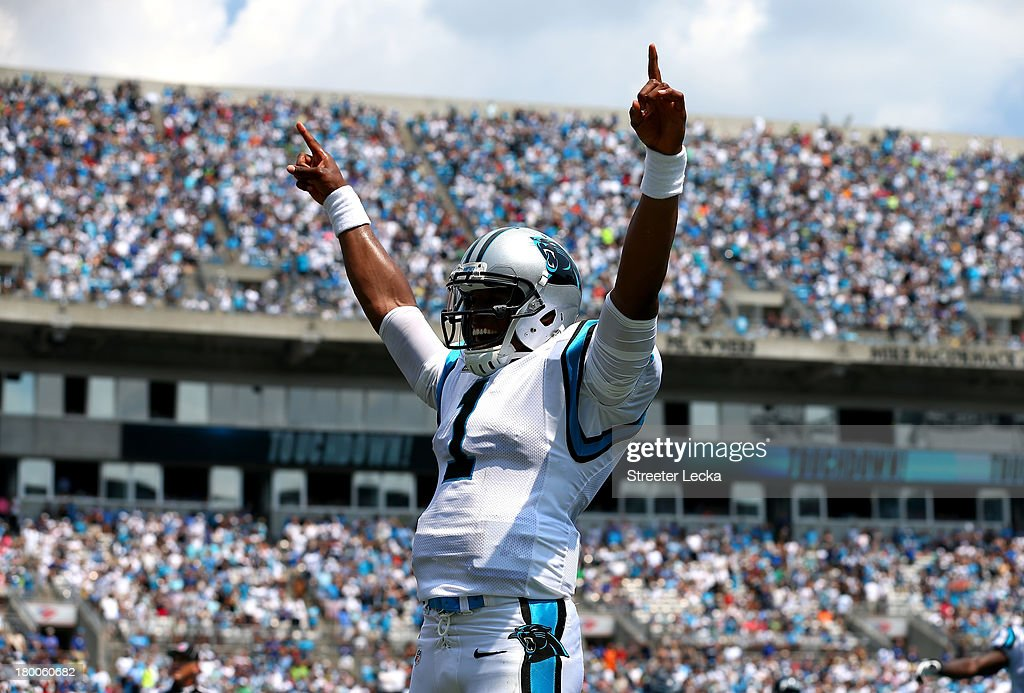 <a gi-track='captionPersonalityLinkClicked' href=/galleries/search?phrase=Cam+Newton+-+American+Football+Quarterback&family=editorial&specificpeople=4516761 ng-click='$event.stopPropagation()'>Cam Newton</a> #1 of the Carolina Panthers celebrates after throwing a touchdown to Steve Smith #89 against the Seattle Seahawks during their game at Bank of America Stadium on September 8, 2013 in Charlotte, North Carolina.