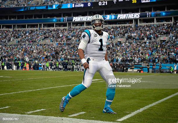 Cam Newton of the Carolina Panthers celebrates during the NFC Divisional Playoff Game against the Seattle Seahawks at Bank of America Stadium on...
