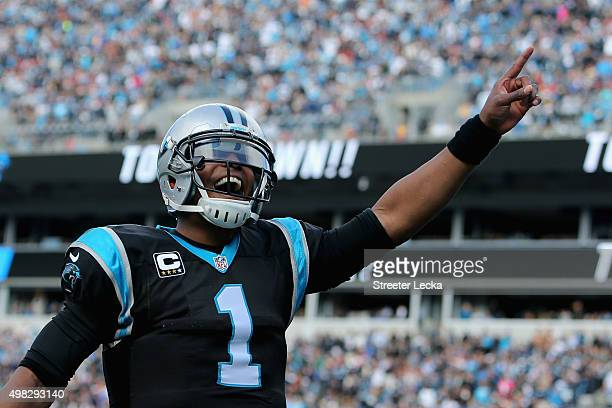 Cam Newton of the Carolina Panthers celebrates teammate Mike Tolbert's touchdown run against the Washington Redskins in the 1st quarter during their...