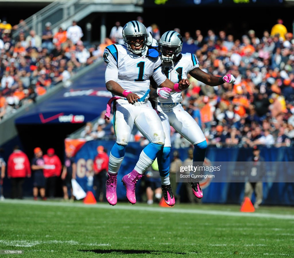 Cam Newton #1 of the Carolina Panthers celebrates with Brandon LaFell #11 after scoring against the Chicago Bears at Soldier Field on October 2, 2011 in Chicago, Illinois.