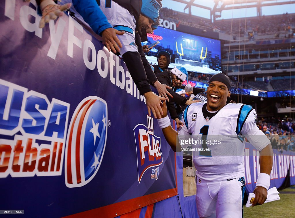 Cam Newton #1 of the Carolina Panthers celebrates with fans after defeating the New York Giants in their game at MetLife Stadium on December 20, 2015 in East Rutherford, New Jersey. The Carolina Panthers defeated the New York Giants with a score of 38 to 35.