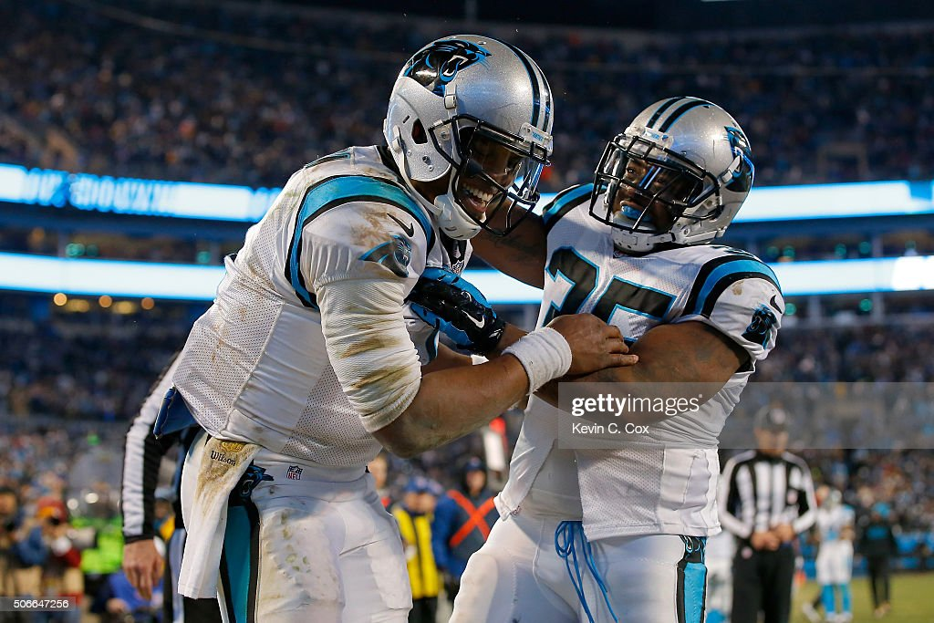Cam Newton #1 of the Carolina Panthers celebrates with Mike Tolbert #35 after scoring a touchdown in the third quarter against the Arizona Cardinals during the NFC Championship Game at Bank of America Stadium on January 24, 2016 in Charlotte, North Carolina.