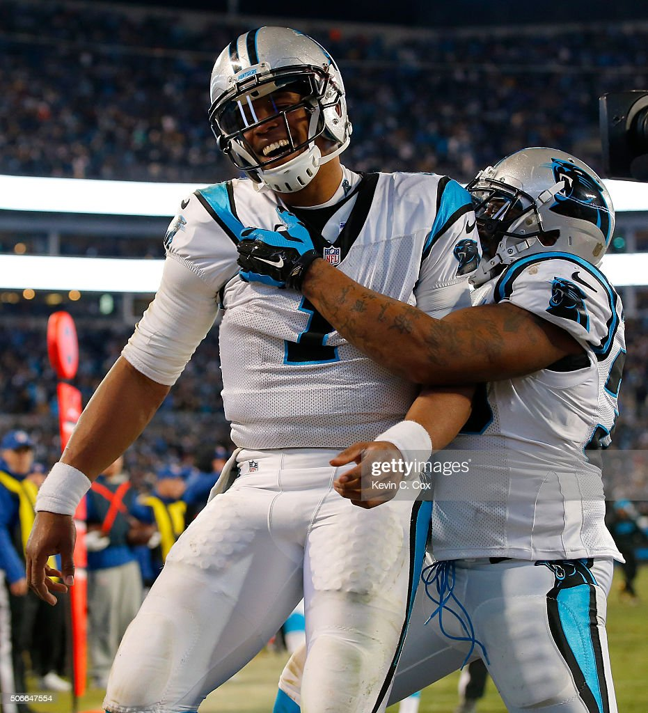 Cam Newton of the Carolina Panthers celebrates with Mike Tolbert after scoring a touchdown in the third quarter against the Arizona Cardinals during...