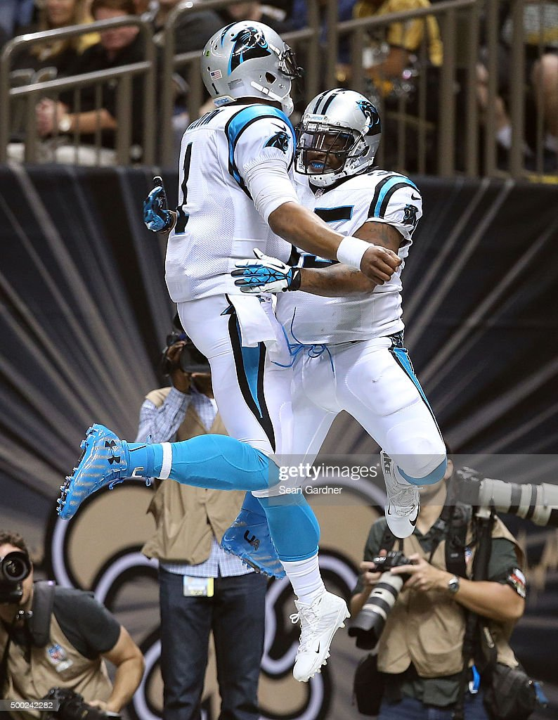 Cam Newton of the Carolina Panthers celebrates with Mike Tolbert of the Carolina Panthers after scoring a touchdown against the New Orleans Saints at...