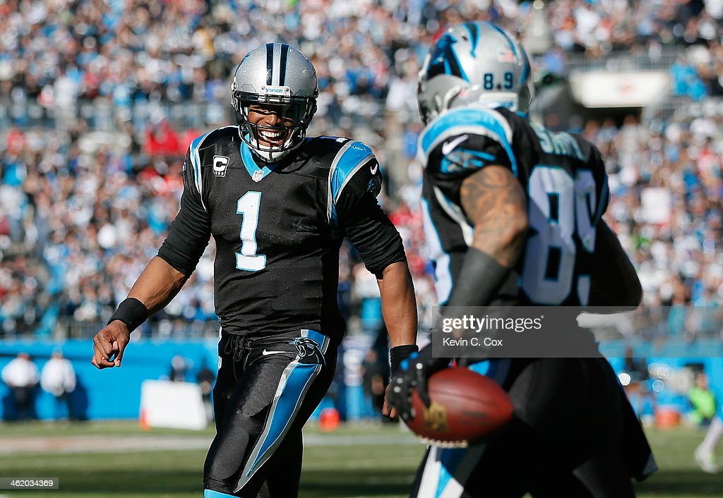 <a gi-track='captionPersonalityLinkClicked' href=/galleries/search?phrase=Cam+Newton+-+American+Football+Quarterback&family=editorial&specificpeople=4516761 ng-click='$event.stopPropagation()'>Cam Newton</a> #1 of the Carolina Panthers celebrates with Steve Smith #89 after a touchdown in the second quarter against the San Francisco 49ers during the NFC Divisional Playoff Game at Bank of America Stadium on January 12, 2014 in Charlotte, North Carolina.
