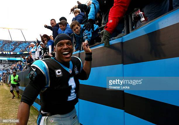 Cam Newton of the Carolina Panthers celebrates with the fans after defeating the Cleveland Browns 1713 at Bank of America Stadium on December 21 2014...