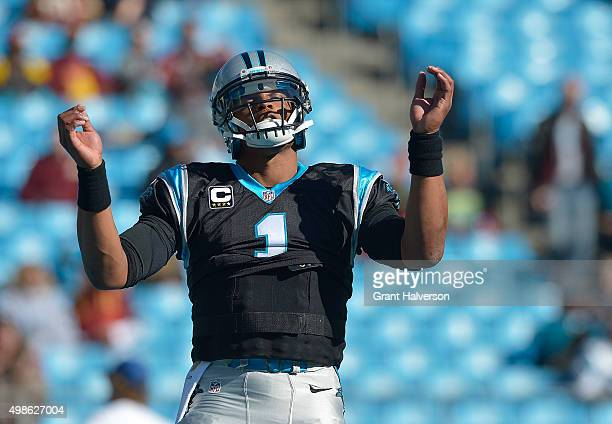 Cam Newton of the Carolina Panthers dances as he warms up during their game against the Washington Redskins at Bank of America Stadium on November 22...