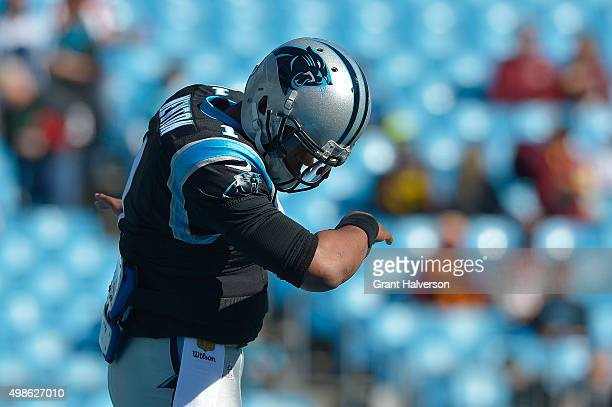 Cam Newton of the Carolina Panthers dances The Dab as he warms up during their game against the Washington Redskins at Bank of America Stadium on...