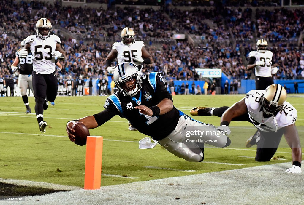 Cam Newton of the Carolina Panthers dives into the end zone for a touchdown against the New Orleans Saints during the third quarter of their game at...