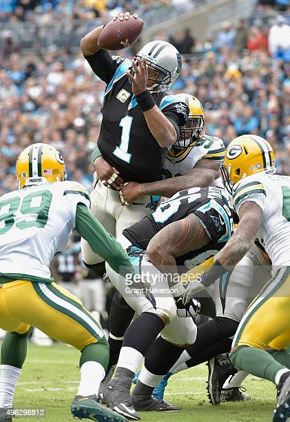 Cam Newton of the Carolina Panthers dives into the end zone for a touchdown during the second quarter of their game against the Green Bay Packers at...