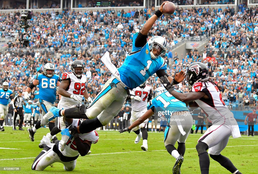 Cam Newton #1 of the Carolina Panthers dives into the end zone for a touchdown during the second quarter of their game against the Atlanta Falcons at Bank of America Stadium on November 5, 2017 in Charlotte, North Carolina.