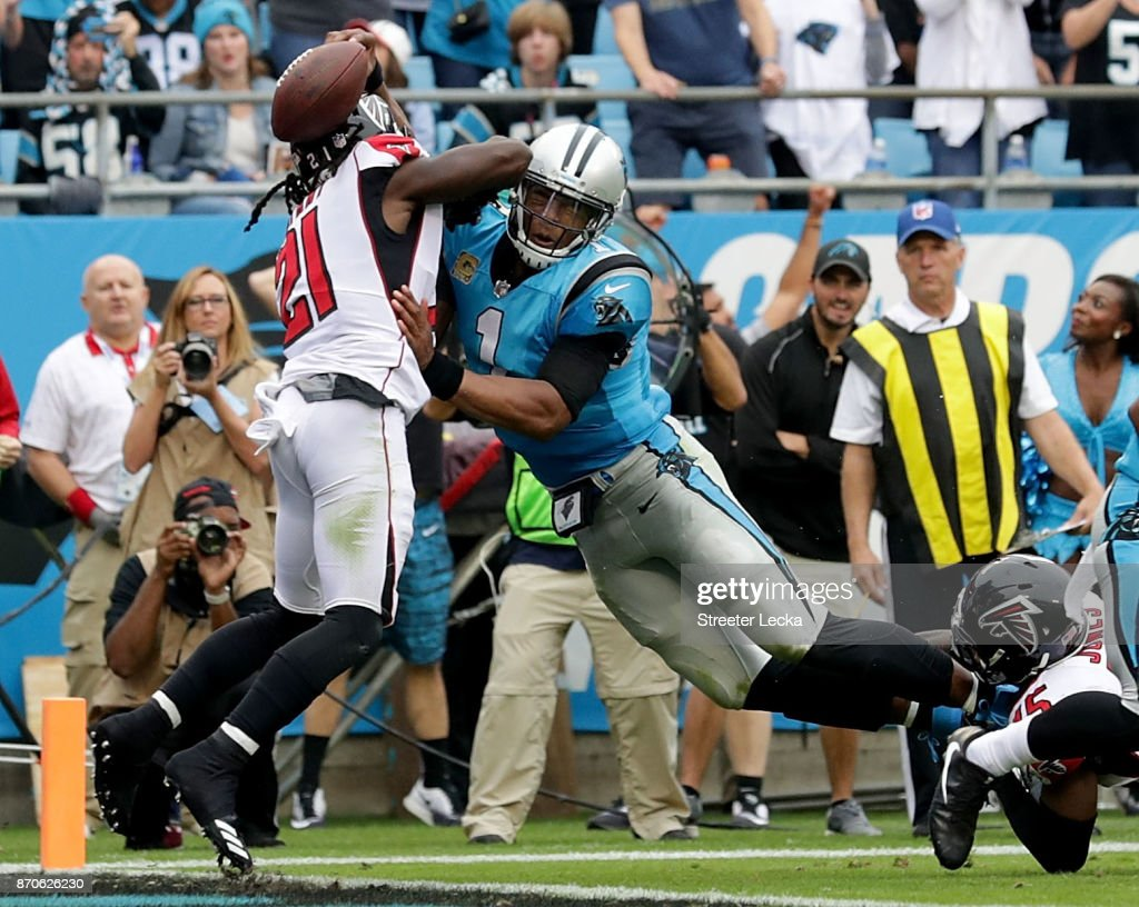 Cam Newton #1 of the Carolina Panthers dives over Desmond Trufant #21 of the Atlanta Falcons for a touchdown in the second quarter during their game at Bank of America Stadium on November 5, 2017 in Charlotte, North Carolina.