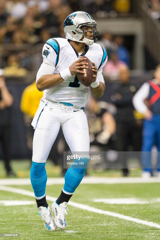 Cam Newton #1 of the Carolina Panthers drops back to pass against the New Orleans Saints at Mercedes-Benz Superdome on December 30, 2012 in New Orleans, Louisiana. The Panthers defeated the Saints 44-38.