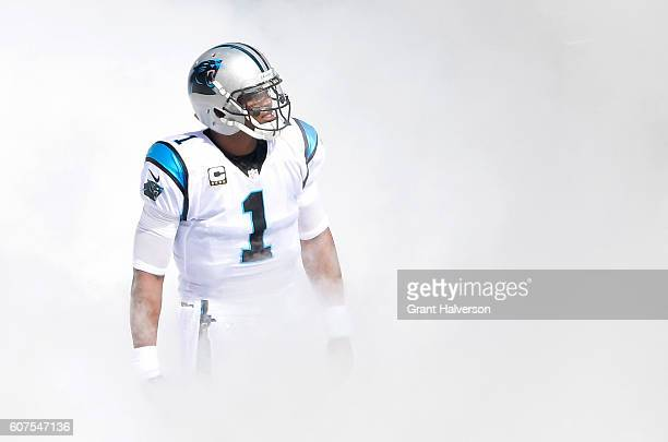 Cam Newton of the Carolina Panthers emerges from the smoke before their game against the San Francisco 49ers at Bank of America Stadium on September...