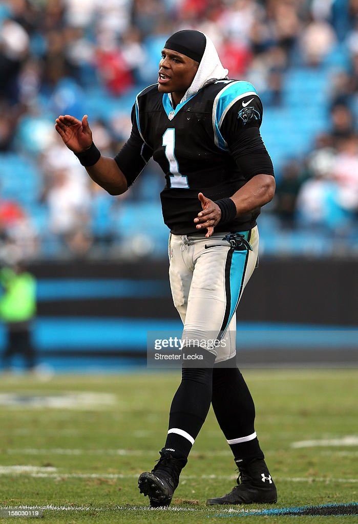 Cam Newton #1 of the Carolina Panthers encourages the defense late in the fourth quarter during their game against the Atlanta Falcons at Bank of America Stadium on December 9, 2012 in Charlotte, North Carolina.