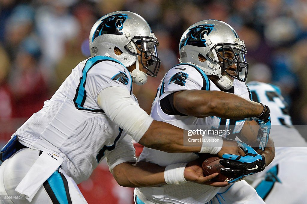 Cam Newton of the Carolina Panthers fakes the handoff to Mike Tolbert in the third quarter against the Arizona Cardinals during the NFC Championship...