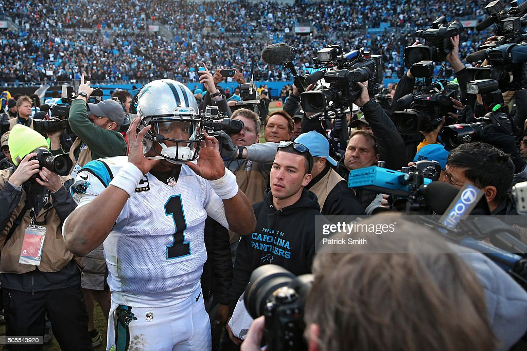 Cam Newton #1 of the Carolina Panthers gets swarmed by the media after their, 31-24 victory over the Seattle Seahawks at the NFC Divisional Playoff Game at Bank of America Stadium on January 17, 2016 in Charlotte, North Carolina.