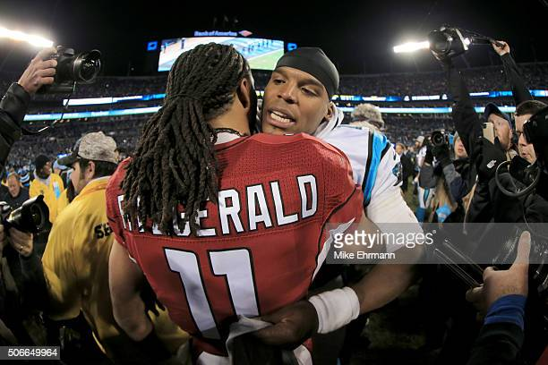 Cam Newton of the Carolina Panthers hugs with Larry Fitzgerald of the Arizona Cardinals after the NFC Championship Game at Bank of America Stadium on...