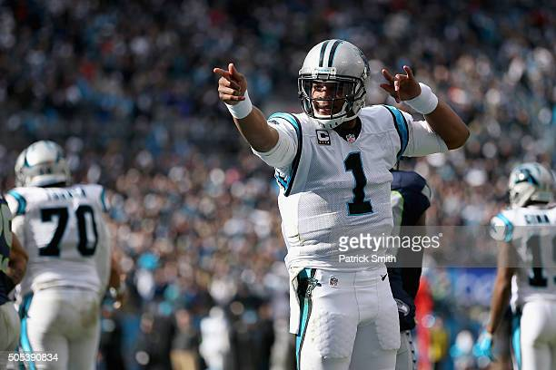 Cam Newton of the Carolina Panthers indicates a first down against the Seattle Seahawks in the 1st quarter during the NFC Divisional Playoff Game at...