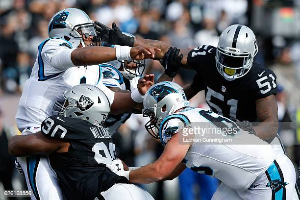 Cam Newton of the Carolina Panthers is hit by Dan Williams of the Oakland Raiders during their NFL game on November 27 2016 in Oakland California