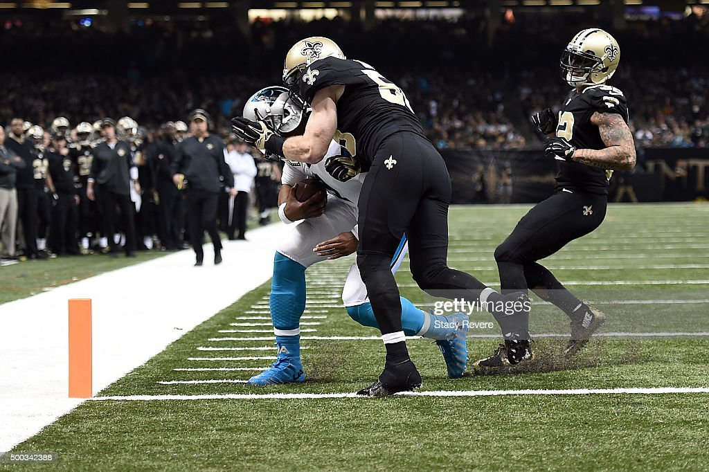 <a gi-track='captionPersonalityLinkClicked' href=/galleries/search?phrase=Cam+Newton+-+American+Football+Quarterback&family=editorial&specificpeople=4516761 ng-click='$event.stopPropagation()'>Cam Newton</a> #1 of the Carolina Panthers is hit by <a gi-track='captionPersonalityLinkClicked' href=/galleries/search?phrase=Michael+Mauti&family=editorial&specificpeople=5630085 ng-click='$event.stopPropagation()'>Michael Mauti</a> #56 of the New Orleans Saints during a game at the Mercedes-Benz Superdome on December 6, 2015 in New Orleans, Louisiana. Carolina defeated New Orleans 41-38.