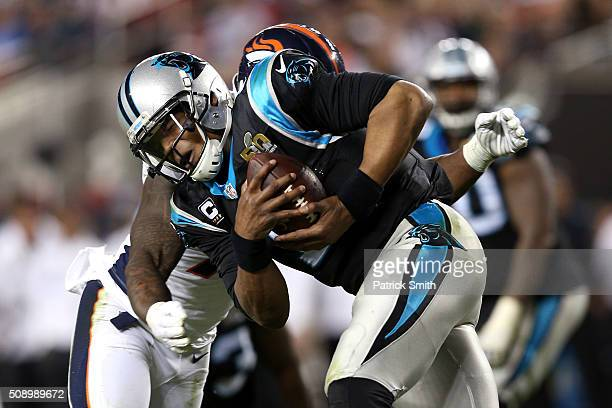 Cam Newton of the Carolina Panthers is hit in the fourth quarter against the Denver Broncos during Super Bowl 50 at Levi's Stadium on February 7 2016...