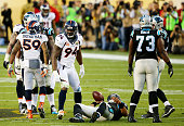Cam Newton of the Carolina Panthers lays on the ground after being sacked by DeMarcus Ware of the Denver Broncos in the second quarter during Super...