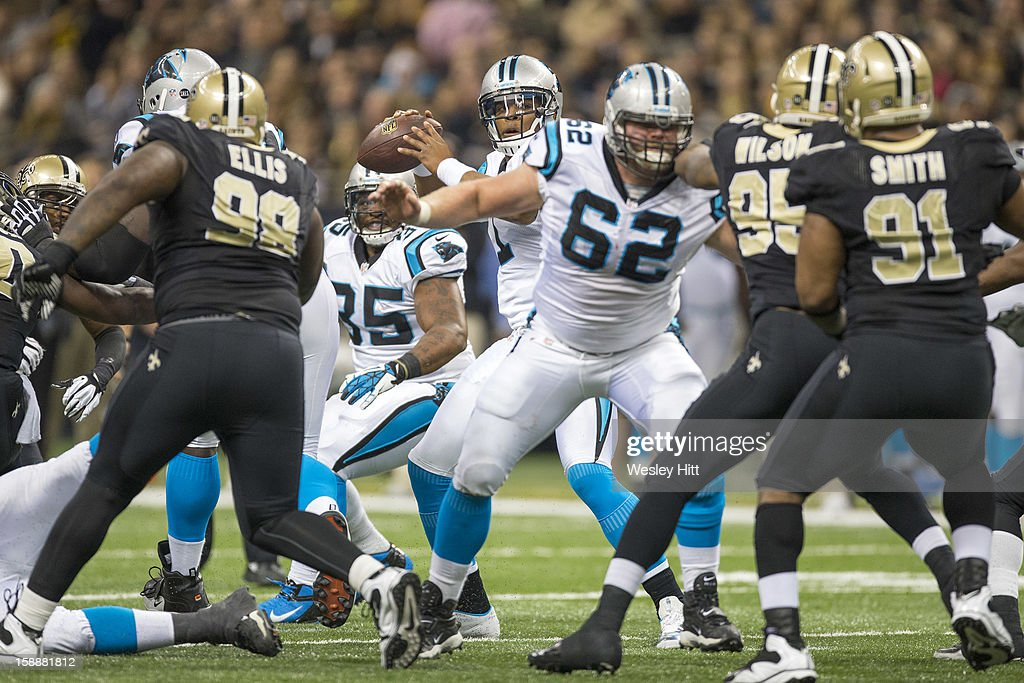 Cam Newton #1 of the Carolina Panthers looks to pass against the New Orleans Saints at Mercedes-Benz Superdome on December 30, 2012 in New Orleans, Louisiana. The Panthers defeated the Saints 44-38.