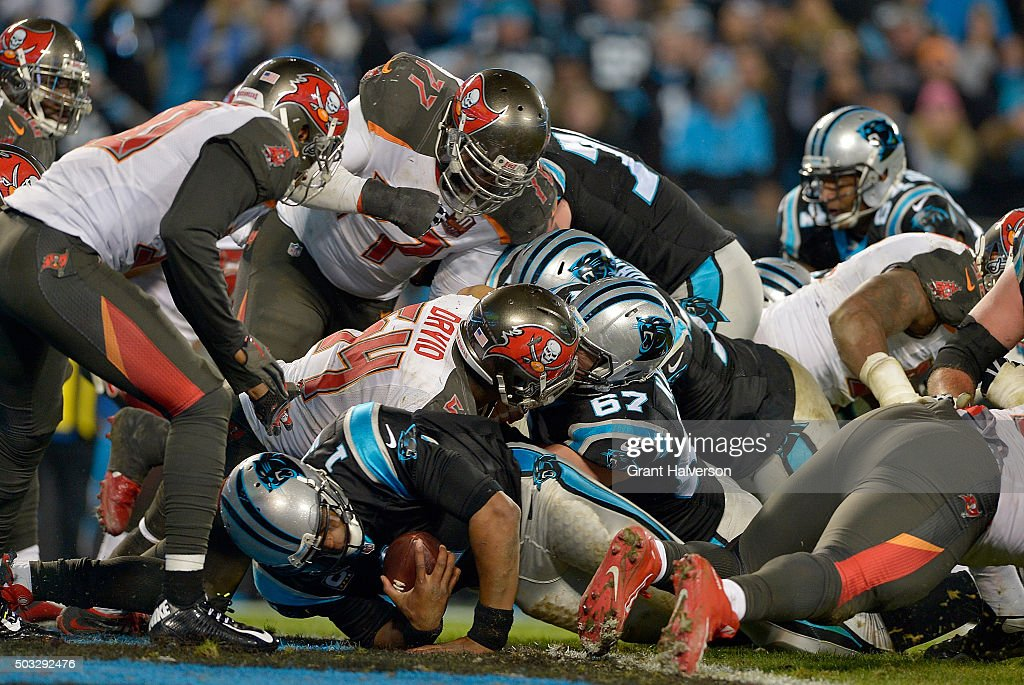 Cam Newton #1 of the Carolina Panthers lunges across the goal line against the Tampa Bay Buccaneers in the 3rd quarter during their game at Bank of America Stadium on January 3, 2016 in Charlotte, North Carolina.