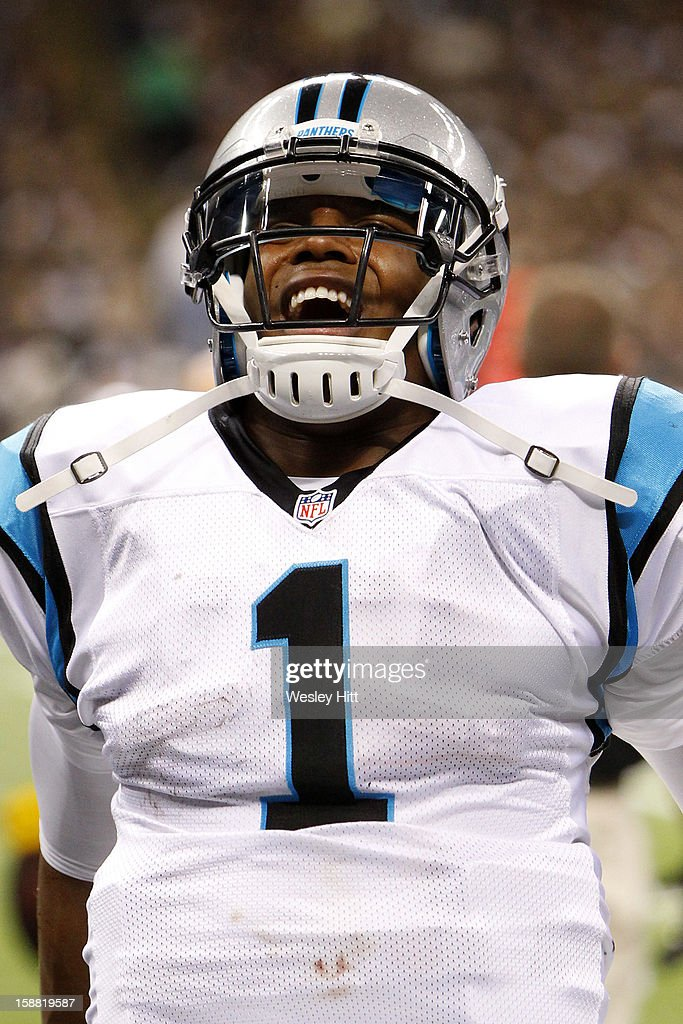Cam Newton #1 of the Carolina Panthers on the sidelines in pain while having his ankle wrapped during a game against the New Orleans Saints at Mercedes-Benz Superdome on December 30, 2012 in New Orleans, Louisiana. The Panthers defeated the Saints 44-38.