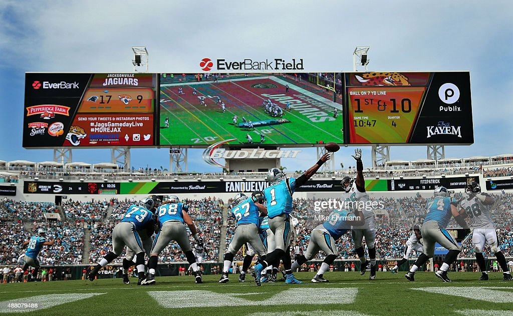 Cam Newton of the Carolina Panthers passes during a game against the Jacksonville Jaguars at EverBank Field on September 13 2015 in Jacksonville...