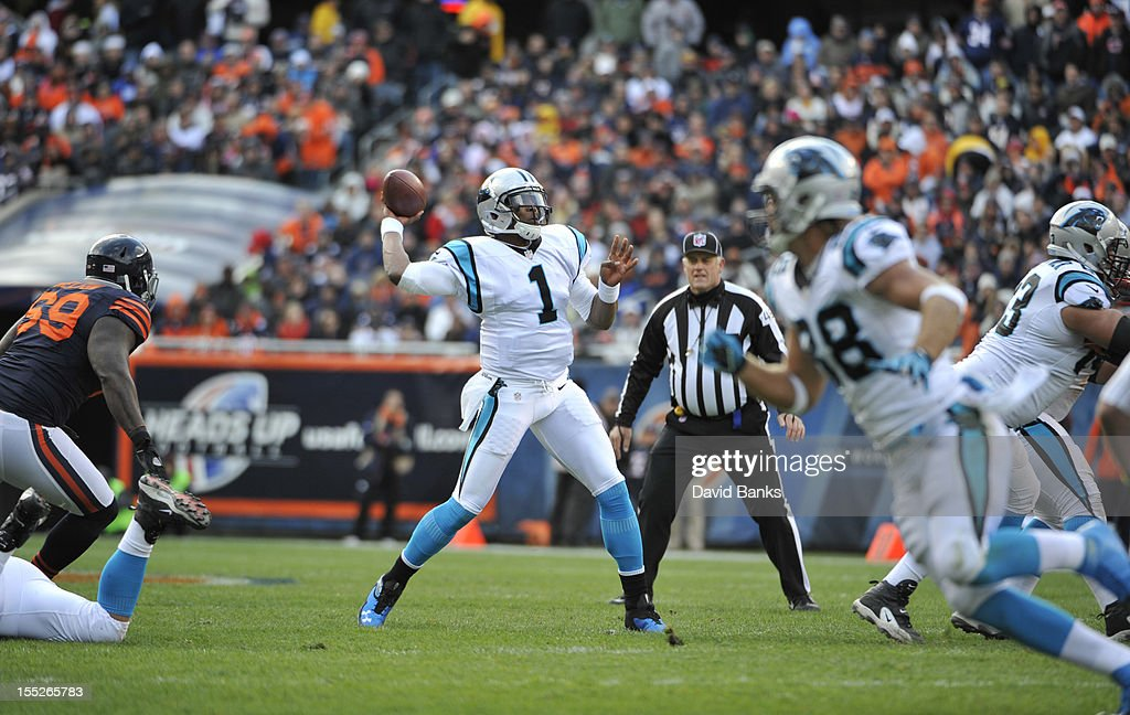 Cam Newton #1 of the Carolina Panthers passes the ball against the Chicago Bears on October 28, 2012 at Soldier Field in Chicago, Illinois.