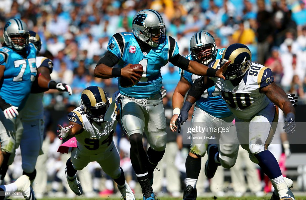 <a gi-track='captionPersonalityLinkClicked' href=/galleries/search?phrase=Cam+Newton+-+American+Football+Quarterback&family=editorial&specificpeople=4516761 ng-click='$event.stopPropagation()'>Cam Newton</a> #1 of the Carolina Panthers pushes away from <a gi-track='captionPersonalityLinkClicked' href=/galleries/search?phrase=Michael+Brockers&family=editorial&specificpeople=7174354 ng-click='$event.stopPropagation()'>Michael Brockers</a> #90 of the St. Louis Rams during their game at Bank of America Stadium on October 20, 2013 in Charlotte, North Carolina.